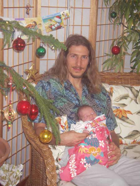 Andy and Leilani in front of the Christmas tree