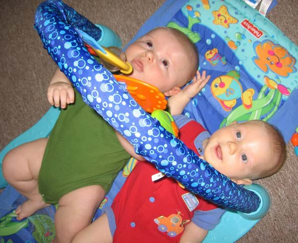 Ian and Leilani playing in Ian's gym