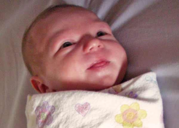 Leilani 6 days old smiling