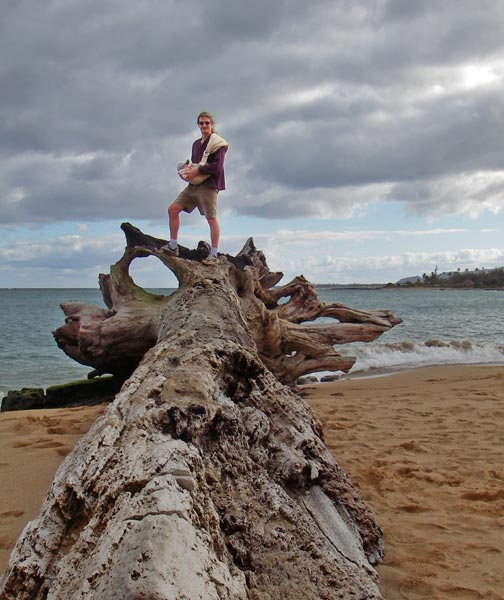 Andy on a log on Wailua Beach